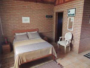 Cama ou camas em um quarto em Tocas do Lago