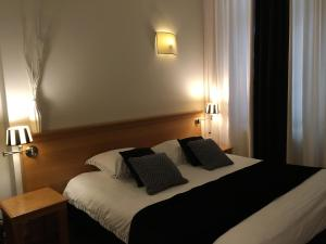 A bed or beds in a room at Chambres D'Hotes Rekko
