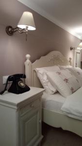 Ένα ή περισσότερα κρεβάτια σε δωμάτιο στο Ξενώνας Γιογκαράκης