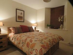 A bed or beds in a room at The Barn @ The Coach House
