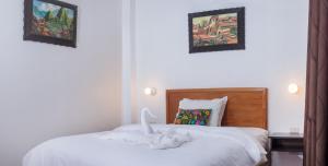 Un ou plusieurs lits dans un hébergement de l'établissement The Tayta Hostal