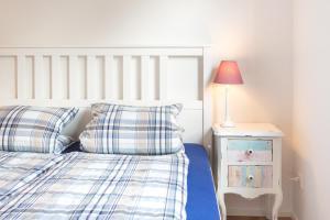 Кровать или кровати в номере Sarnen Apartment 1