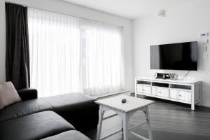 Ein Sitzbereich in der Unterkunft Superior Apartment Sarnen
