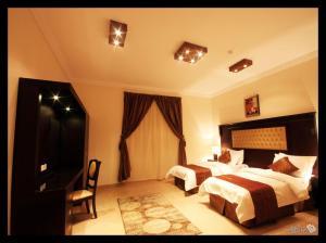 سرير أو أسرّة في غرفة في ترف ينبع