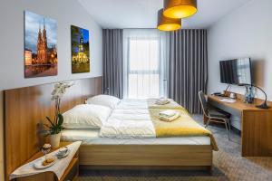 Łóżko lub łóżka w pokoju w obiekcie Hotel Garden