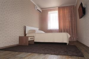 Кровать или кровати в номере Апартаменты на Кировском проспекте