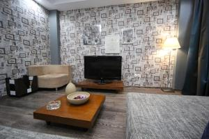 A television and/or entertainment center at Athina Airport Hotel