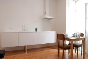A cozinha ou kitchenette de Coimbra Vintage Lofts Apartments