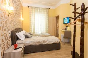 Letto o letti in una camera di BQ House Castello Luxury Rooms