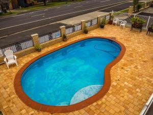 The swimming pool at or near Casino Motor Inn