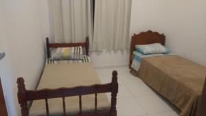 Cama ou camas em um quarto em Cobertura Praia Dos Ingleses
