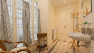 A bathroom at Portico Ottavia Garden Apartment