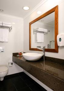 A bathroom at Caesar Premier Jerusalem Hotel