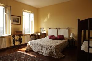 Letto o letti in una camera di Ca'Magna