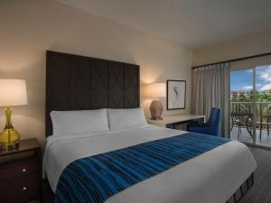 A bed or beds in a room at Marriott's Grande Vista