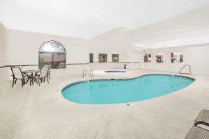 The swimming pool at or near Days Inn by Wyndham Lamar