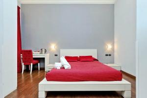 Кровать или кровати в номере Relais At Via Veneto