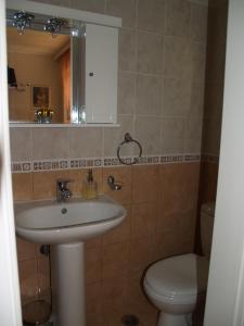 A bathroom at Villa Verde Apart-Hotel
