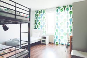 A bunk bed or bunk beds in a room at StayInn Hostel und Gästehaus