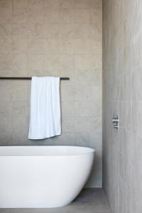 A bathroom at Larmont Sydney by Lancemore