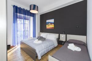 Letto o letti in una camera di B&B Albergo Sicilia