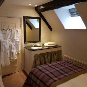 A bathroom at Macdonald Bear Hotel