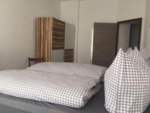 Ein Bett oder Betten in einem Zimmer der Unterkunft Apartment Nicole