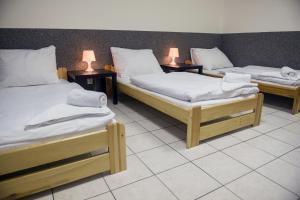 Кровать или кровати в номере Hostel Seven