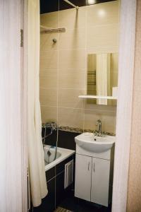 Ванная комната в Olensflat on Lysaya Gora