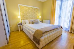 A bed or beds in a room at Colours Apartments Budapest