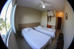 Cama ou camas em um quarto em Hotel Flex