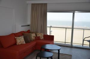 Ein Sitzbereich in der Unterkunft Apartment Beach