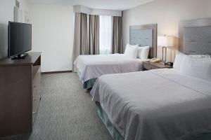 A bed or beds in a room at Homewood Suites by Hilton Albuquerque Uptown