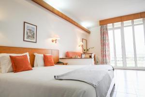 Cama o camas de una habitación en Hotel Apartamento Pantanha