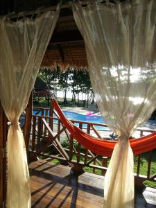 A view of the pool at Koh Jum Lodge or nearby