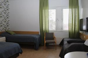 Vuode tai vuoteita majoituspaikassa Meri-Karina