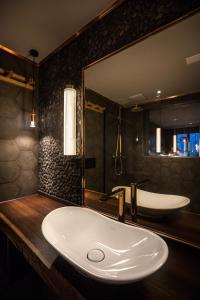 Salle de bains dans l'établissement HUUS Gstaad