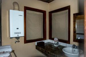 A bathroom at Xaus Lodge