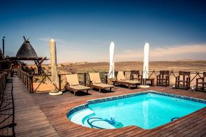 The swimming pool at or near Xaus Lodge
