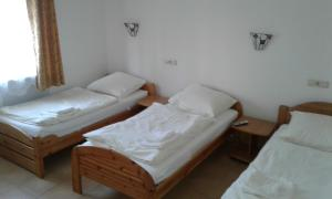 A bed or beds in a room at Wanderlust Hostel