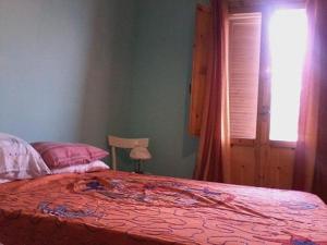 Letto o letti in una camera di Casa Diego solaria porto cesareo