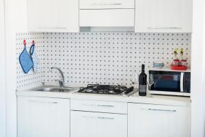 A kitchen or kitchenette at Appartamento Daniela