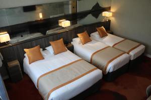 Un ou plusieurs lits dans un hébergement de l'établissement Hotel De La Digue