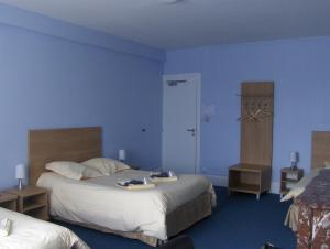 Un ou plusieurs lits dans un hébergement de l'établissement La Tour de Crecy