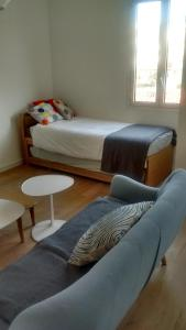 A bed or beds in a room at Appartement Design Scandinave - Vue sur Mer