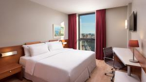 A bed or beds in a room at Four Points by Sheraton Barcelona Diagonal