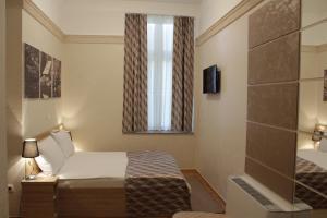 Krevet ili kreveti u jedinici u objektu Hotel Kurija Janković