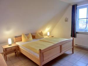 Ein Bett oder Betten in einem Zimmer der Unterkunft Villa Hermes