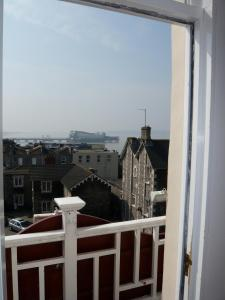 A balcony or terrace at Queenswood Hotel