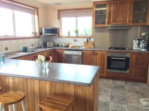 A kitchen or kitchenette at Penguin Seaside Homestay